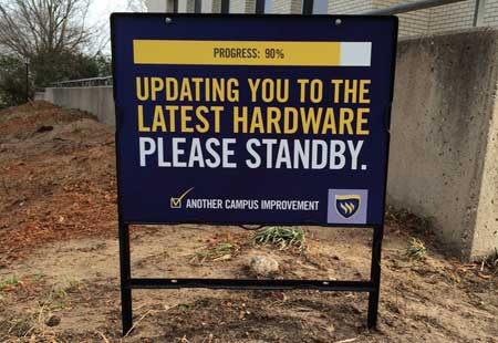 "Texas Wesleyan campus improvement sign says, ""Updating you to the latest hardware. Please standby."""